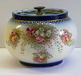 Blushware tobacco jar decorated with Heather pattern.