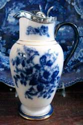 Carlton Ware flow blue Hibiscus jug with silver mount