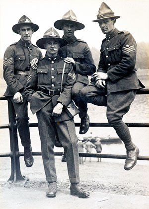 Four New Zealand soldiers wearing campaign hats.